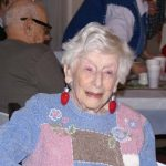 Elderly woman with Christmas Lightbulb Earrings at a Christmas Party at Ledgeview Assisted Living