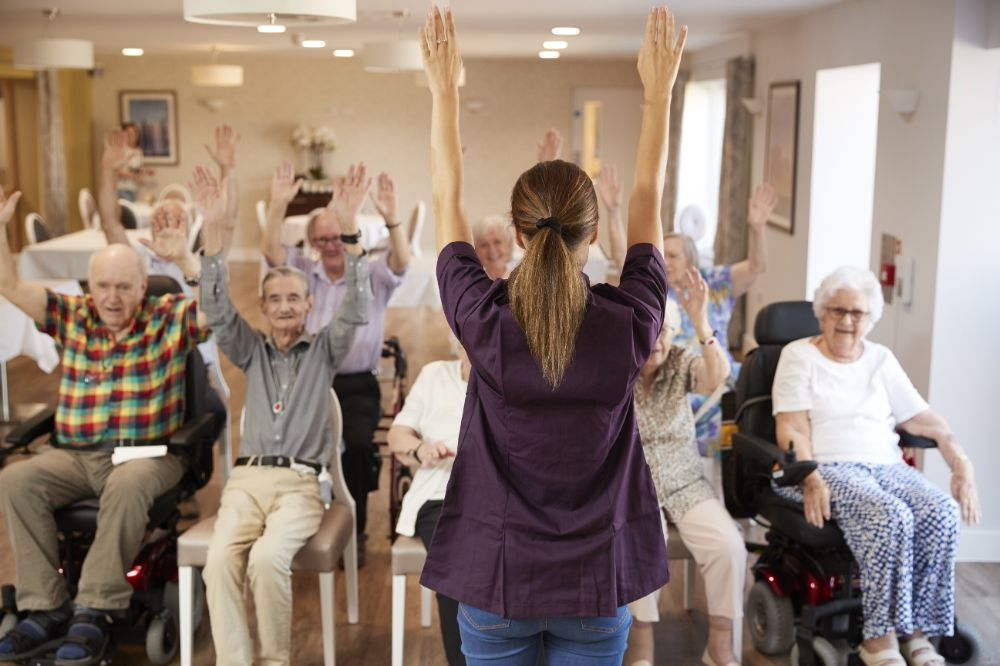 caregiver giving stretching instructions